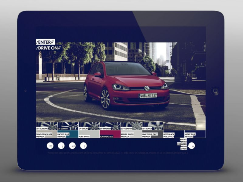 An iPad with an application running, showing a car in the center and a list of colors along the bottom